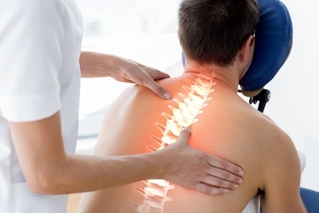 physiotherapist: Digital composite of Highlighted spine of man at physiotherapy