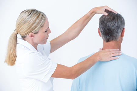 chiropractic: Doctor doing neck adjustment