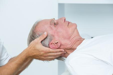 medical man: Man receiving head massage in medical office