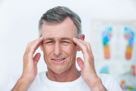 Patient with headache in medical office