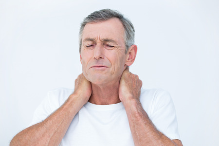 wincing: Patient with neck ache in medical office