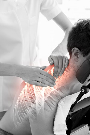 physiotherapy: Digital composite of Highlighted spine of man at physiotherapy