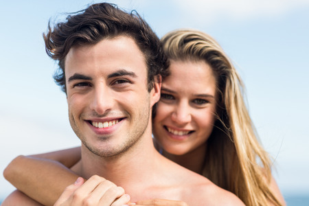 romantic sexy couple: Happy couple in swimsuit embracing at the beach Stock Photo