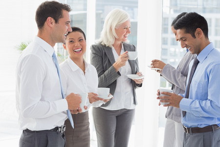 break: Happy work team during break time in office Stock Photo