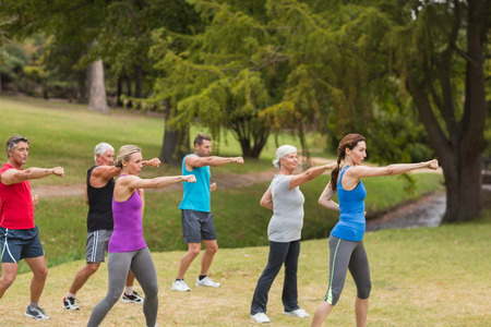 senior adult woman: Athletic group showing their fists on a sunny day Stock Photo