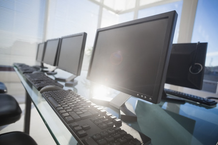 computer monitor: Computer with headsets at office