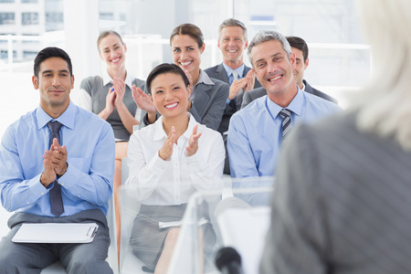 applauding: Business people applauding during meeting in office Stock Photo