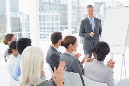 acclamation: Businessman doing speech during meeting in office Stock Photo