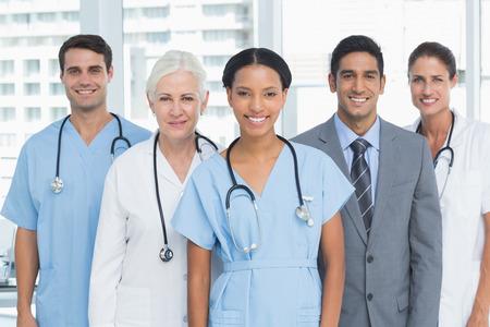 medical doctors: Portrait of confident doctors standing in medical office