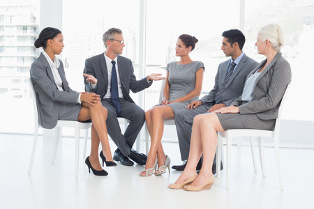 mature business man: Business people in board room meeting at the office