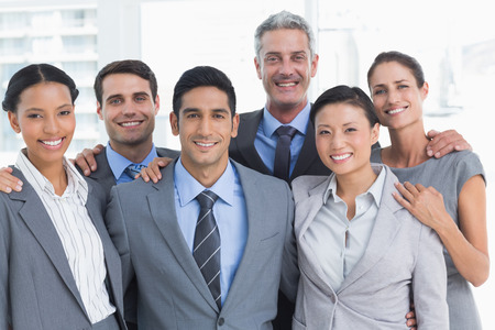 young business people: Portrait of happy young business people standing in office