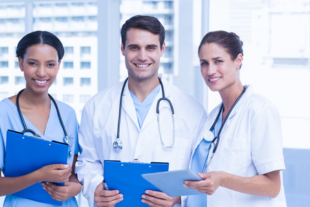male nurse: Portrait of doctors with arms crossed at medical office Stock Photo
