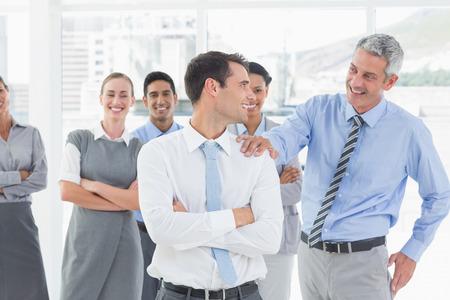 congratulating: Businessman congratulating his colleagues in office