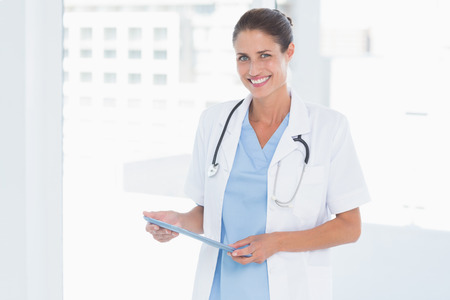 Portrait of a smiling confident female doctor at medical office
