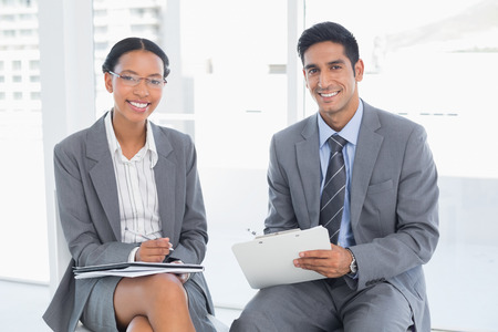 executive woman: Two young business people in board room meeting at office Stock Photo