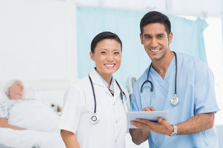 medical doctors: Portrait of confident doctors with arms crossed at medical office