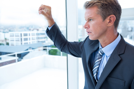 mature business man: Businessman looking out the window in his office