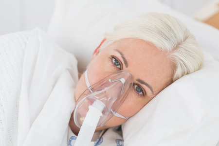 reanimation: a patient with an oxygen mask in the hospital Stock Photo
