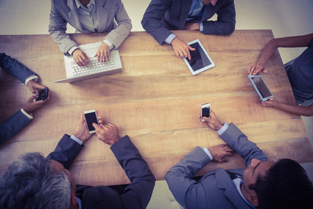 executive: Business people in meeting with new technologies at the office Stock Photo