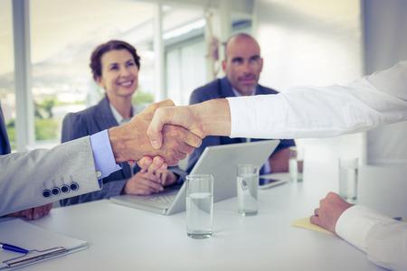 interview job: La gente de negocios d�ndose la mano en la entrevista en la oficina Foto de archivo