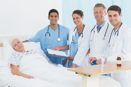 doctor with stethoscope: Doctor explaining report to female patient in the hospital