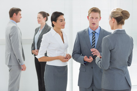 people interacting: Business people interacting in the meeting room