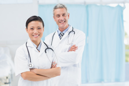 male and female: Confident male and female doctors at medical office