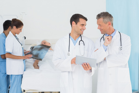 hospital patient: Report reading with patient behind  in the hospital Stock Photo