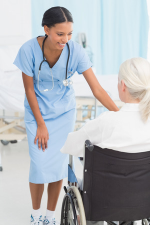 hospital patient: doctors and patient in wheelchair at the hospital
