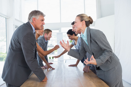 Irritated business team arguing in the office