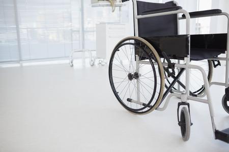 paraplegico: Composite image of black wheelchair in hospital