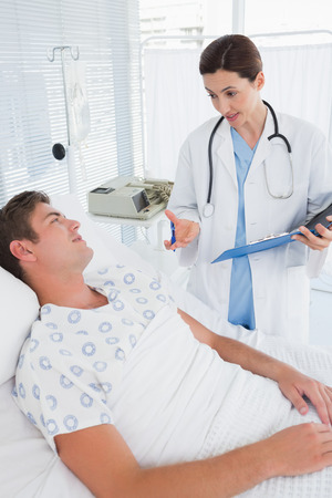 recuperation: Doctor taking care of patient in hospital room Stock Photo