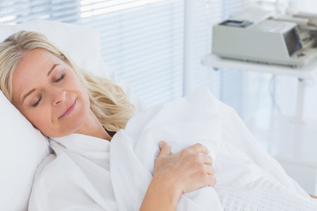 hospital patient: Happy patient lying on her bed in hospital Stock Photo