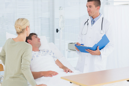hospital patient: Doctor checking his patient in hospital room