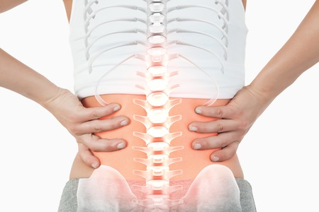 part of body: Digital composite of Highlighted spine of woman with back pain Stock Photo