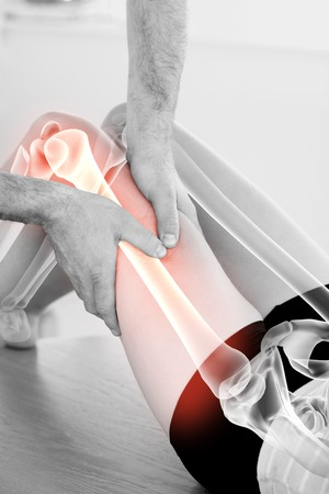 physiotherapy: Digital composite of Highlighted bones of woman at physiotherapist Stock Photo