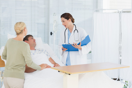 hospital patient: Doctor checking her patient in hospital room