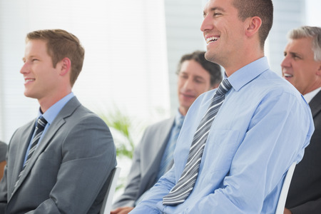 staff training: Businessmen listening conference presentation in meeting room Stock Photo