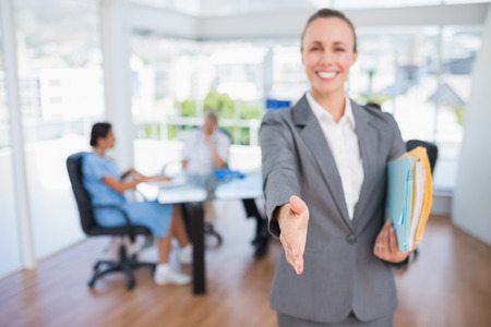introducing: Smiling businesswoman introducing herself in medical office