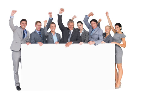 coworkers: Excited business team holding poster on white background
