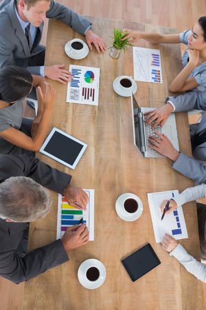 well dressed: Business team discussing the graphs in the office Stock Photo