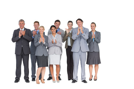 acclamation: Smiling business team applauding at camera on white background