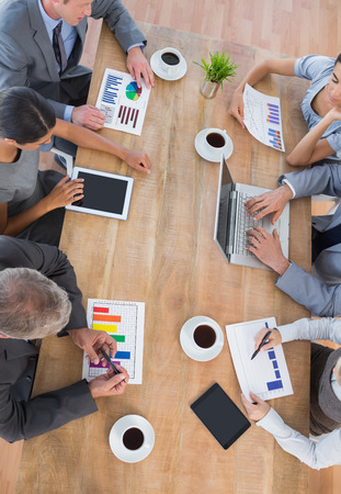 mature adult: Business team discussing the graphs in the office Stock Photo