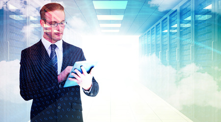 unsmiling: Unsmiling businessman using tablet pc against digitally generated server room with towers