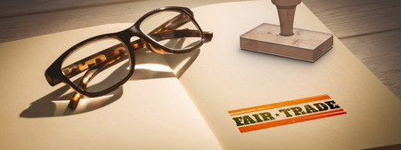 fair trade: Fair Trade graphic against glasses on notepad