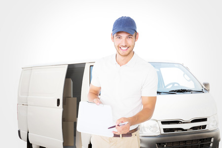 vans: Happy delivery man holding clipboard against white delivery van