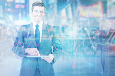 mirror image: Businessman using his tablet pc  against mirror image of city skyline Stock Photo
