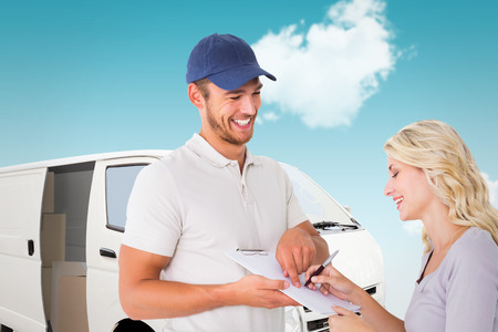 happy workers: Happy delivery man getting signature from customer against blue sky