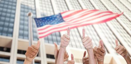 sky scraper: Thumbsup against american flag against sky scraper