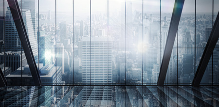 A large room with a large window looking onto the city Stock Photo